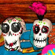 """Day of the Dead sugar skulls, made from sugar paste and decorated with icing, are used to adorn altars and can be eaten. """"The sugar represents the sweetness of life, and the skull represents the sadness of death,"""" according to Amy Luscinski, author of a paper on Day of the Dead."""