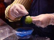 A candy maker creates a monster-themed treat at Fantasyland's Storybook Circus.