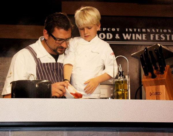 Chef Chris Cosentino and his son in a cooking demonstration
