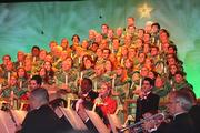 A mass choir provides the vocals for several holiday songs.