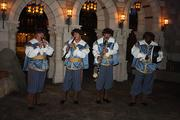 A musical troupe in Fantasyland provide guests with fun tunes and quick jokes.