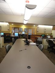 The nurses station also features a conference room table that allows the nurses, doctors and other caregivers to meet and talk about patients.