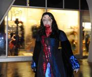 Scare actors surprise guests as they roam the streets during Halloween Horror Nights.