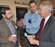 Bill Oakley of Goodwill Industries, with Miguel Gonzalez and Bill Rush of Insurance Office of America