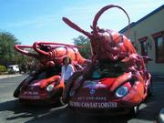 Jeff Hazell, founder/president of Bar Harbor Lobster Co. Inc., drives the Lobster Mobile, a red 2009 Volkswagen Beetle with a 14-foot lobster on top.