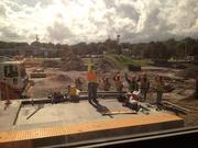 Construction workers greet SunRail sneak peek ride attendees from the Maitland SunRail station site.