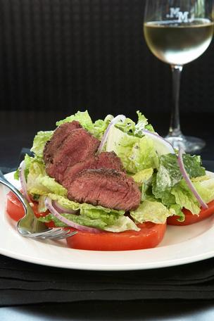 A steak salad from Marlow's Tavern, which is set to open in the fall at Pointe Orlando.