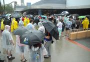 The shallow alcove surrounding the Superstar Shop wasn't quite deep enough to shelter the fans looking for the limited edition Star Wars merchandise.
