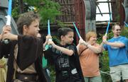 Some young Jedi hopefuls and their parents got some hands-on time with a lightsaber in the Jedi Training Academy.