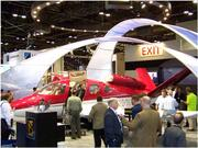 Exhibitor displays from aircraft manufacturers at the Orange County  Convention Center during a previous National Business Aviation  Association convention.