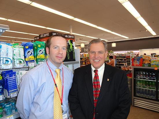 From left: Mark Fraser, store manager of Walgreens at North Lakemont Ave. and Aloma Ave., and Marlin Hutchens, market vice president for Walgreens Co.