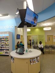 The new pharmacies inside the revamped Walgreens are designed by the same company that designed the Apple Inc. retail stores.