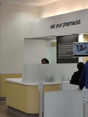 The pharmacists in the revamped Walgreens stores aren't behind the counter, but instead sit out and are more accessible to customers.