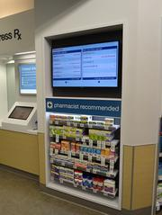 In the new pharmacy, customers can see who's in line ahead of them.