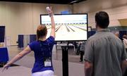 Conventioners take a break and play a game of Wii Bowling at a video game station on the exhibitor room. Break areas and snack stations were located around the convention floor.