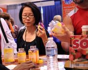 Jacqueline Pe of New York samples vitamin supplements at the Nature Made booth.