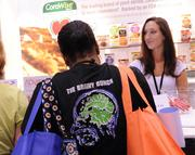 Neurology Nurse Practitioner Noella West wears her nursing team t-shirt while she browses the exhibitor room.