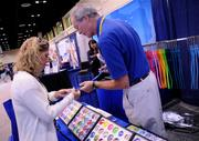Nurse Practitioner Janet Baugh of Indiana (left) shops for a new stethoscope at the UltraScope booth.