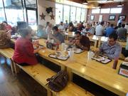 Orlando Business Journal editorial staff celebrates winning 12 Florida Press Association Awards by eating lunch at the new 4 Rivers Smokehouse in Winter Park.