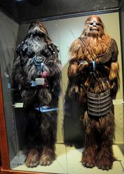 Wookiee costumes from Revenge of the Sithon display inStar Wars: Where Science Meets Imaginationat Orlando Science Center.