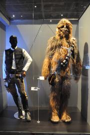 Han Solo and Chewbacca costumes from the original Star Wars trilogyon display inStar Wars: Where Science Meets Imaginationat Orlando Science Center.