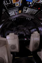 Inside the cockpit of the Millenium Falcon Interactive ExperienceinStar Wars: Where Science Meets Imaginationat Orlando Science Center.