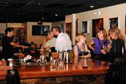 A growing crowd of patrons gather at the bar at the On The Rocks Third Thursday art event.
