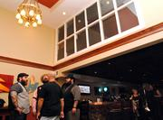 High ceilings and open space allow for large crowds and live music at On The Rocks.