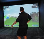 Halo meets The Masters as a golfer chooses a course display on a virtual golf swing trainer. Technology rocks!