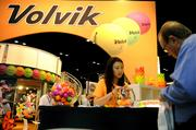 Brightly colored golf balls are shown off with a brightly colored display on the exhibitor floor.