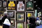 PGA show guests check out a collection of sports memorabilia at the Harrods display.