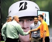 A networking session is photobombed by a display featuring pro golfer Brandt Snedeker.