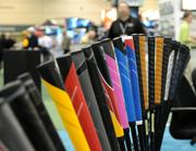 A rainbow of custom club grips is displayed in the exhibitor room. Color plays a big role in the game of golf.