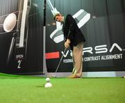 Doug Rutherford of the Penn State Pro Golf Management Program takes a practice swing on a putting green display. Rutherford was on hand with other classmates for lectures and learning experience at the PGA show.