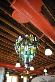 A wine bottle chandelier hangs in the R. C. StevensConstruction Co. office in downtown Winter Garden.