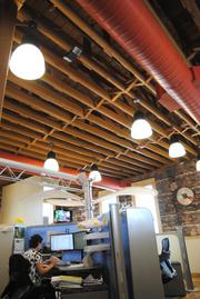 The offices have an old-world feel with a nod to new technology and office concepts.