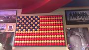 Baseballs in the shape of an American Flag hangs on the wall inside Central Florida's first Red Robin restaurant.