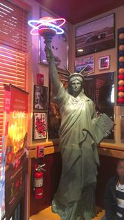 The Statue of Liberty sports a burger on its torch instead of a flame inside the new Red Robin restaurant in Winter Garden.