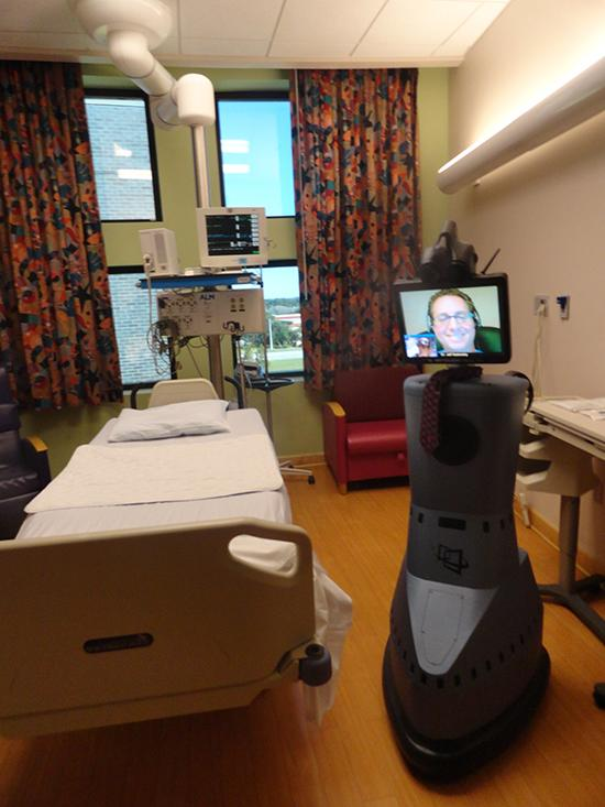 Dr. Jeffrey Sadowsky, a critical care specialist and director of Telemedecine in Critical Care at Orlando Health through the robot RP-7.