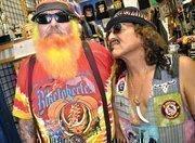 """Johnny Rock N Ride"" (right) mugs with friend and associate ""Sundown"" at John's Rock N Ride on Main Street during Biketoberfest."