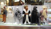 A selection of character dolls from A Christmas Carol include Scrooge, all three ghosts, Marley and Bob Cratchit, and Tiny Tim.