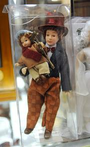 Detail of the Bob Cratchit and Tiny Tim set from the Christmas Carol figure collection.