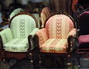 Detail of upholstered chairs with real wood framing