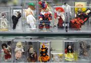 Miniature dolls for playroom environments fill their own display case.