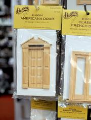 Miniature doors and windows are available, unpainted, for builds or doll home improvement projects.