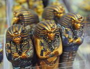 A bin of highly detailed miniature sarcophagi is among the astounding finds in Ron's shop.