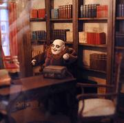 Uncle Fester of the Adams Family inhabits the library of a monster-themed house in the museum.