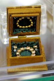 A jewelry box with a mirrored top to show off the necklace and earrings inside