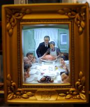 A shadow box containing a three-dimensional version of Norman Rockwell's Thanksgiving painting.