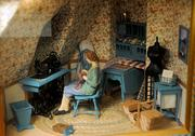 A sewing room is among the many custom built interior environments at the Ron's Miniatures museum.